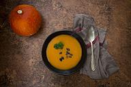 Organic pumpkin soup in black bowl - LVF05357