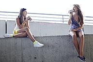 Two teenage girls using tin can phone - FSF00539