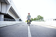 Teenage boy riding bicycle - FSF00551