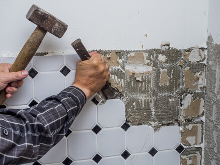 Tiles being removed from wall during a refurbishment - EJWF00796