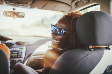 Happy young woman in a car - KIJF00784