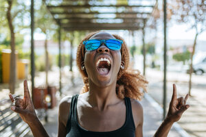Young woman screaming outdoors - KIJF00793
