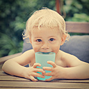 Little boy with plastic cup outdoors - MFF03377