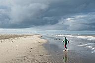 Denmark, Skagen, boy in winter clothes running on beach - MJF02012