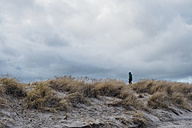 Denmark, Skagen, boy in winter clothes in dunes - MJF02015