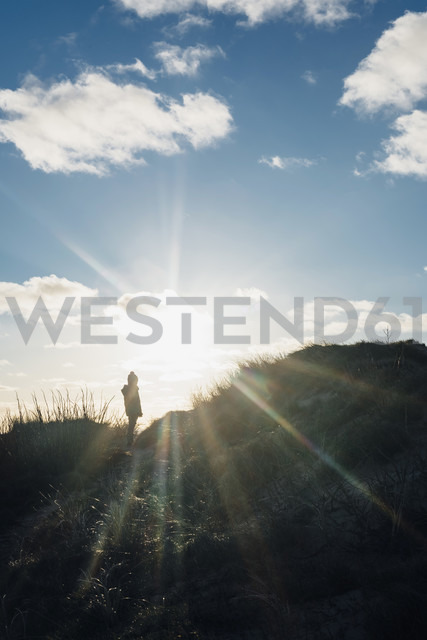 Denmark, North Jutland, boy in dunes in backlight - MJF02051