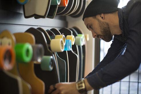 Man shopping for skate boards - ZEF10442