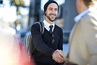 Two men shaking hands outdoors - ZEF10478