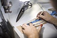 Tailor measuring cloth in designer factory - ZEF10520