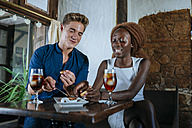 Couple eating and drinking together in restaurant - KIJF00837