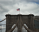 USA, New York City, US flag on Brooklyn Bridge - STCF00251