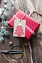 Christmas decoration and wrapped present on wood - SARF02946