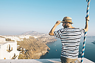 Greece, Santorini, Thira, man looking at view - GEMF01099