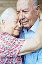 Happy senior woman embracing her husband - GEMF01108