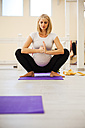 Pregnant woman practicing yoga - ZEDF00363