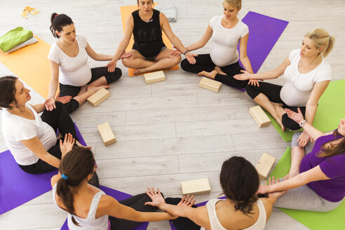 Prenatal yoga class sitting together in circle - ZEDF00369