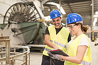 Two colleagues with digital tablet in factory hall - JASF01158