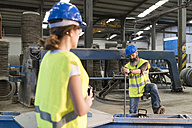 Man and woman in construction materials company - JASF01176