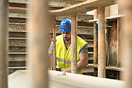 Man working in construction factory - JASF01215