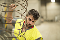 Man working with scrap metal - JASF01224