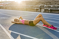 Athlete taking a break after training - MGOF02503