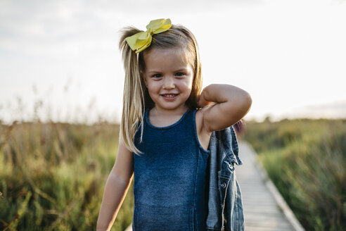Portrait of smiling little girl with hair ribbon - JRFF00868