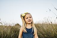 Portrait of smiling little girl with hair ribbon - JRFF00874