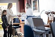 Doctor greeting patients in medical practice - ZEF10551