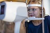 Girl doing eye test at the optometrist - ZEF10554