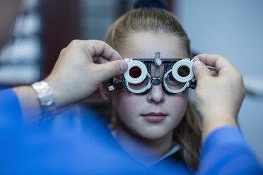 Girl doing eye test at optometrist - ZEF10587