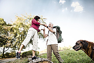 Senior couple with dog on a hike - ONF01022