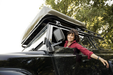 Senior woman on a trip in a cross country vehicle - ONF01052