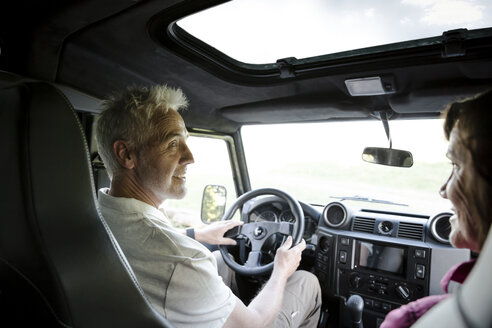Senior couple on a trip in a cross country vehicle - ONF01055