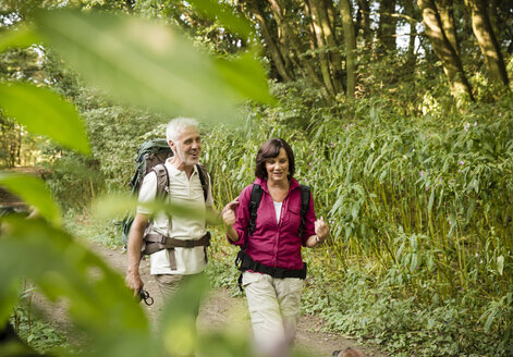 Senior couple hiking on a trail - ONF01064