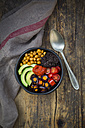 Buddha bowl of black amaranth, avocado, Purple Haze, roasted chickpeas, tomatoes and ajvar - LVF05387