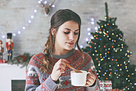 Portrait of woman with cup of coffee at Christmas time - RTBF00423
