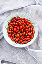 Bowl of goji berries on cloth - SARF02963