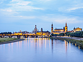 Germany, Saxony, Dresden, historic old town with Elbe River in the foreground in the evening - KRPF01886