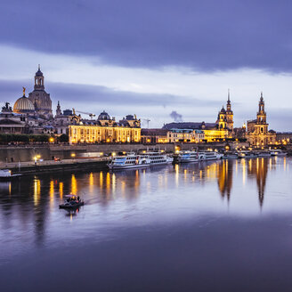 Germany, Saxony, Dresden, historic old town with Elbe River in the foreground in the evening - KRPF01892