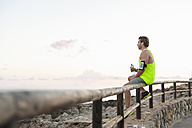 Spain, Mallorca, Jogger with water bottle - DIGF01356