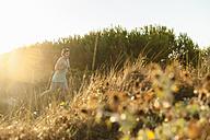Spain, Mallorca, Jogger in dune at sunrise - DIGF01377