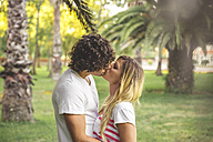 Young couple kissing in park - DAPF00408