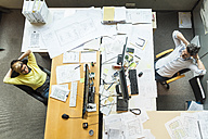 Male and female architects working in office, view from above - TCF05137