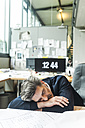 Overworked architect sleeping at desk - TCF05170