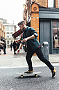 Ireland, Dublin, young skateboarder  on the street - BOYF00618