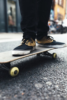 Young skateboarder on the street, partial view - BOYF00621