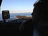 Spain, Tenerife, Boy sitting in car with open window - SIP00920