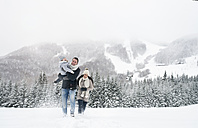 Happy family walking in winter landscape - HAPF00957