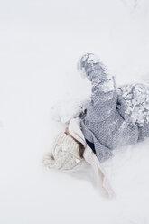 Girl rolling in snow - HAPF00978