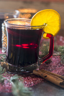 Glass of mulled wine decorated with orange slice - SARF02984